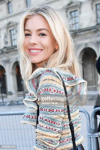 Sienna Miller attends the Louis Vuitton show as part of the Paris Fashion Week Womenswear Fall/Winter 2018/2019 on March 6 2018 in Paris France