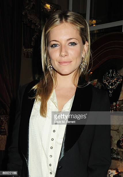 Sienna Miller attends the party to celebrate Kelly Hoppen's MBE received for her services to interior design at Beach Blanket Babylon on March 19...