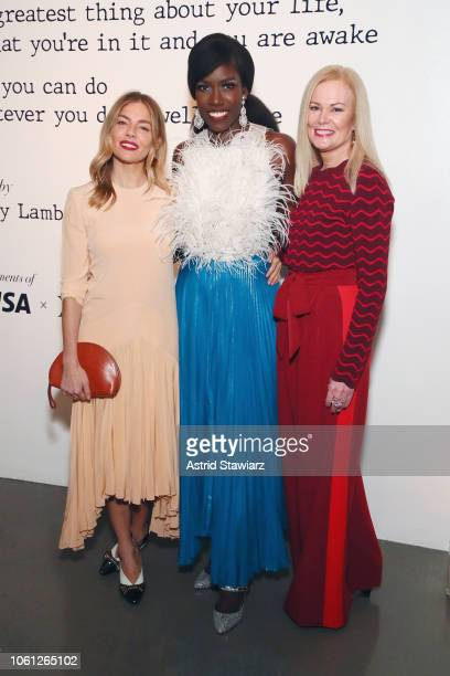 Sienna Miller Bozoma Saint John and Mary Ann Reilly attend the Visa x IMG Fashion Holiday Dinner at The Glasshouses on November 13, 2018 in New York...