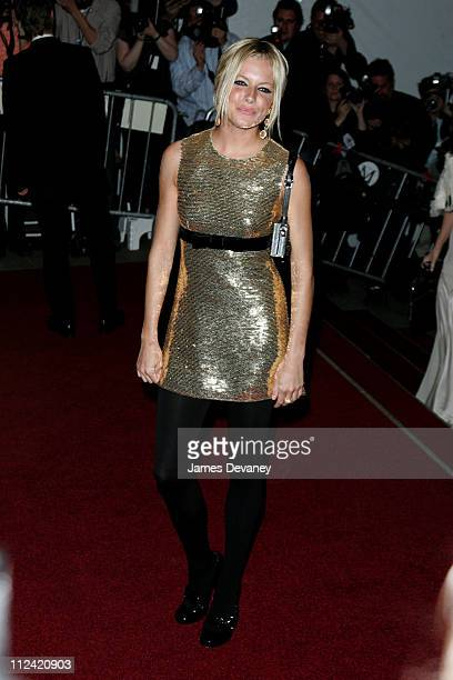 Sienna Miller CoChair of the AngloMania Costume Institute Gala wearing a gold sequinned minidress by Burberry