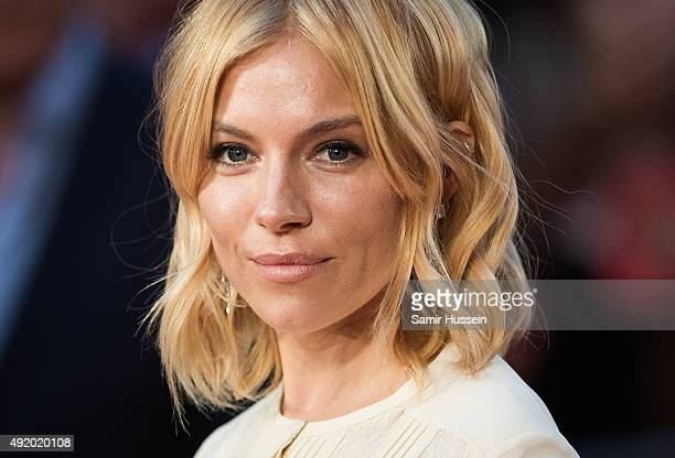Sienna Miller earring detail attends a screening of 'High Rise' during the BFI London Film Festival at Odeon Leicester Square on October 9 2015 in...