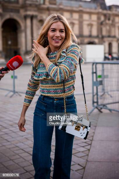 Sienna Miller is seen in the streets of Paris before the Louis Vuitton show during Paris Fashion Week Womenswear Fall/Winter 2018/2019 on March 6...