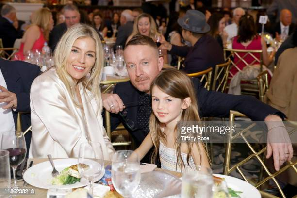 Sienna Miller Jake Scott and Marlowe Ottoline Layng Sturridge attend the International Medical Corps Annual Awards Celebration at The Beverly...