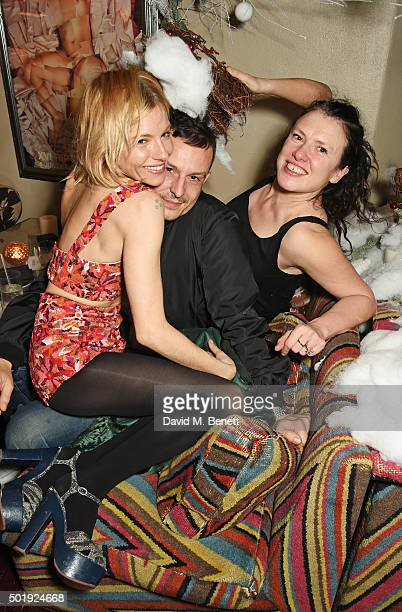 Sienna Miller Jonathan Saunders and Katie Grand attend the LOVE Christmas party at George on December 18 2015 in London England