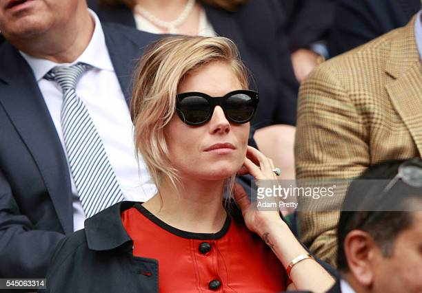 Sienna Miller looks on from The Royal Box on day eight of the Wimbledon Lawn Tennis Championships at the All England Lawn Tennis and Croquet Club on...