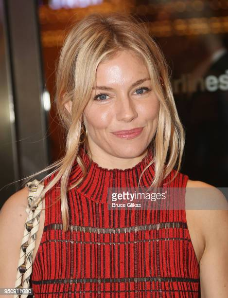 Sienna Miller poses at the opening night of Tom Stoppard's play Travesties on Broadway at The American Airlines Theatre on April 24 2018 in New York...