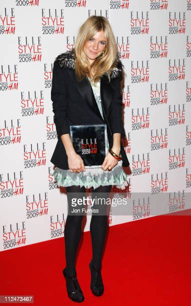 Sienna Miller poses in the Press Room with her award for Style Icon at the ELLE Style Awards 2009 held at Big Sky London Studios on February 9 2009...