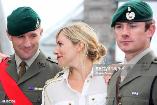 OUT** Sienna Miller poses with Royal Marines at a Photocall to launch 'GI Joe The Rise Of Cobra' held at HMS Belfast on July 22 2009 in London England