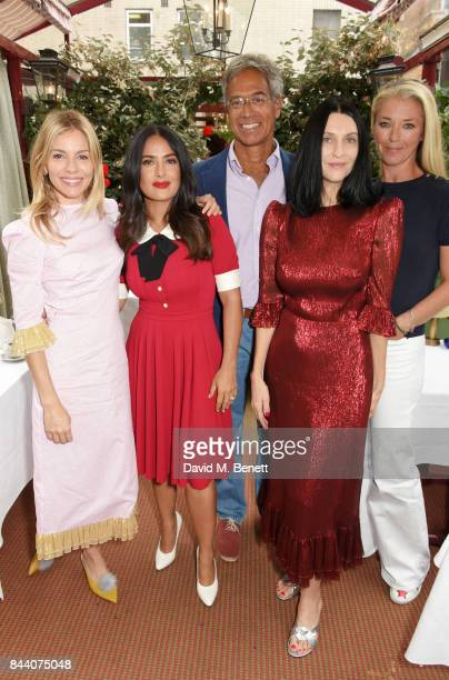 Sienna Miller Salma Hayek Dr Mitch Besser founder of mothers2mothers Susie Cave and Tamara Beckwith attend the mothers2mothers Host Committee...