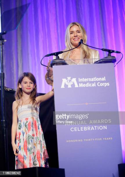 Sienna Miller speaks onstage with daughter Marlowe Ottoline Layng Sturridge at the International Medical Corps Annual Awards Celebration at The...