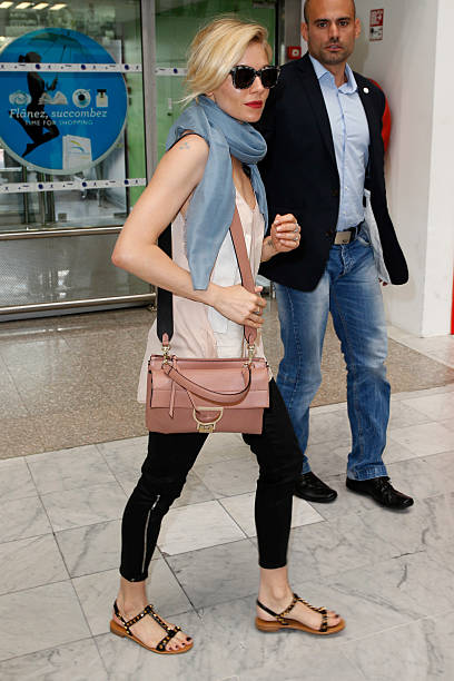 sienna miller spotted at nice airport wearing the new coccinelle arlettis bag photos and images. Black Bedroom Furniture Sets. Home Design Ideas
