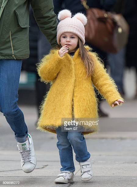 Sienna Miller stopping to get her daughter a cupcake while taking a walk through Soho on February 09 2016 in New York City