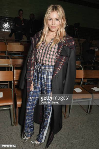 Sienna Miller wearing Burberry at the Burberry February 2018 show during London Fashion Week at Dimco Buildings on February 17 2018 in London England