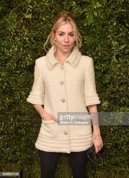 Sienna Miller wearing CHANEL attends Charles Finch and Chanel PreOscar Awards Dinner at Madeo in Beverly Hills on March 3 2018 in Beverly Hills...