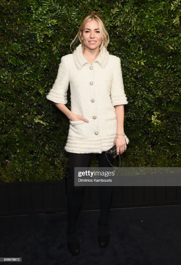 Sienna Miller, wearing CHANEL, attends Charles Finch and Chanel Pre-Oscar Awards Dinner at Madeo in Beverly Hills on March 3, 2018 in Beverly Hills, California.