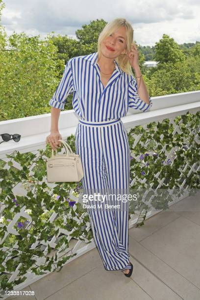 Sienna Miller, wearing Ralph Lauren, attends the Polo Ralph Lauren & British Vogue day during Wimbledon at All England Lawn Tennis and Croquet Club...