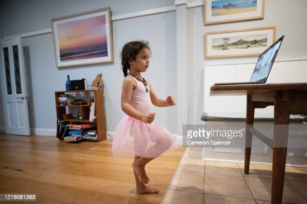 Sienna Spencer daughter of photographer Cameron Spencer is seen watching a ballet class in her home on March 25 2020 in Sydney Australia Around the...