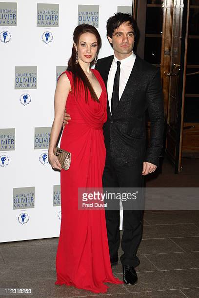 Sierra Boggess and Ramin Karimloo attends The Laurence Olivier Awards at The Grosvenor House Hotel on March 21 2010 in London England