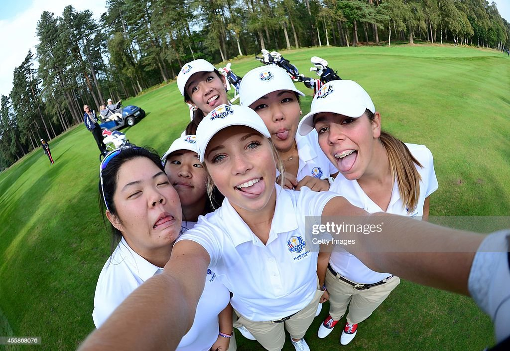 Sierra Brooks of Team USA asks to borrow a camera for a Selfie with her lady team mates, Amy Lee, Andrea Lee, Kristen Gillman, Bethany Wu and Hannah O'Sullivan during the second practice round of the 2014 Junior Ryder Cup - Previews on September 21, 2014 in Perth, Scotland.