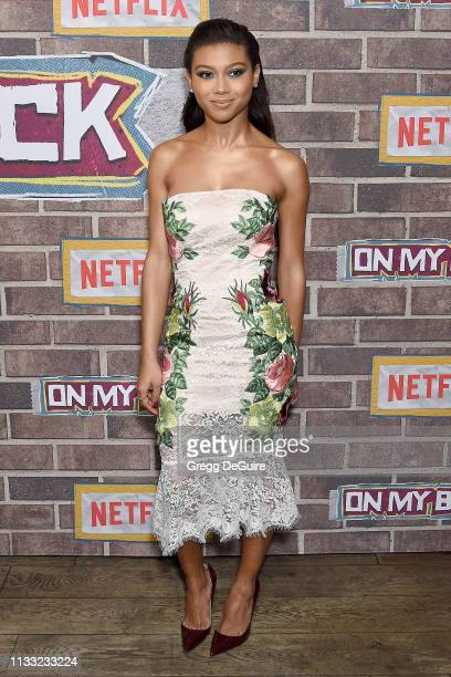 Sierra Capri arrives at the Premiere Of Netflix's On My Block Season 2 at Petty Cash Taqueria on March 27 2019 in Los Angeles California