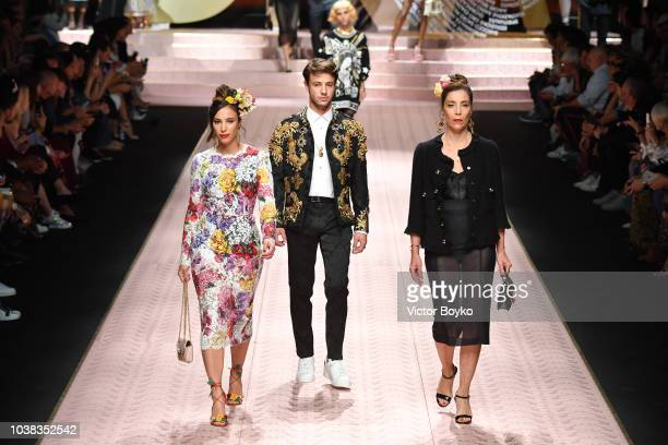 Sierra Dallas Cameron Dallas and Gina Dallas walk the runway at the Dolce Gabbana show during Milan Fashion Week Spring/Summer 2019 on September 23...