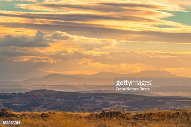Sierra de Guadarrama. Madrid, Spain. Mountains at sunset with stormy clouds and red sky