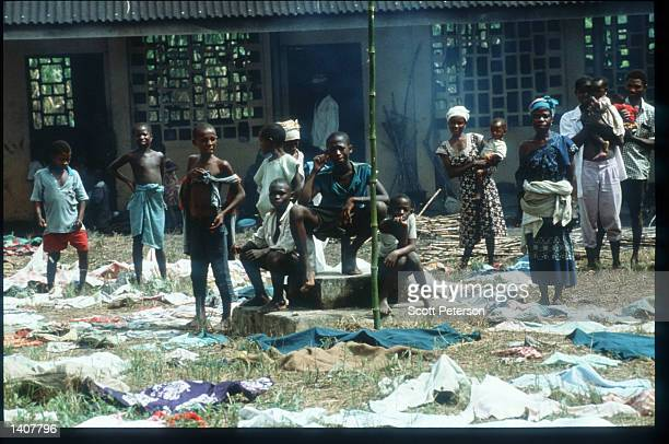 Sierra Leonan refugees sit at an old school in Foya August 10 1992 in Liberia The National Patriotic Front of Liberia which rebelled against the Doe...