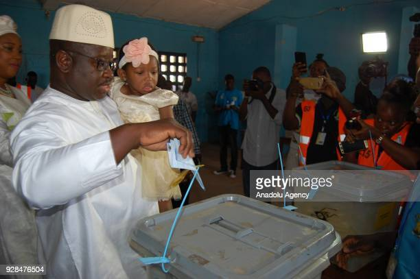 Sierra Leone People's Party's presidential candidate Julius Maada Bio casts his ballot for the elections of Sierra Leones next president members of...