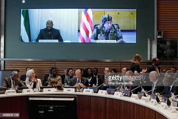 Sierra Leone President Bai Koroma and Liberia President Ellen Johnson Sirleaf join a meeting via video link with Finance ministers and...