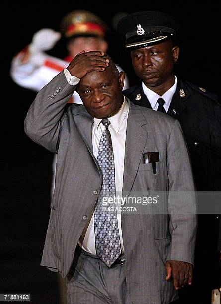 Sierra Leone VicePresident Salomon Berewa gestures upon his arrival at the Jose Marti Airport in Havana 13 September 2006 to participate in the...