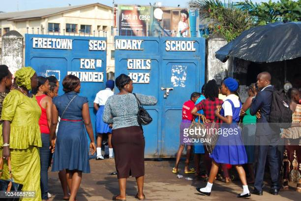 Sierra Leonean children arrive to attend the first day of the new school year on September 17 at the Freetown secondary shcool after the government...