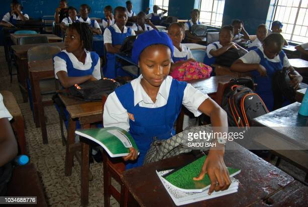 Sierra Leonean children attend the first day of the new school year on September 17 at the Freetown secondary shcool, after the government launched a...