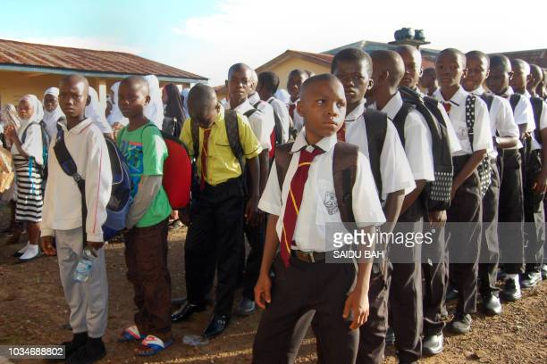 Sierra Leonean children attend the first day of the new school year on September 17 at the Ahmadiyya secondary school in Freetown after the...