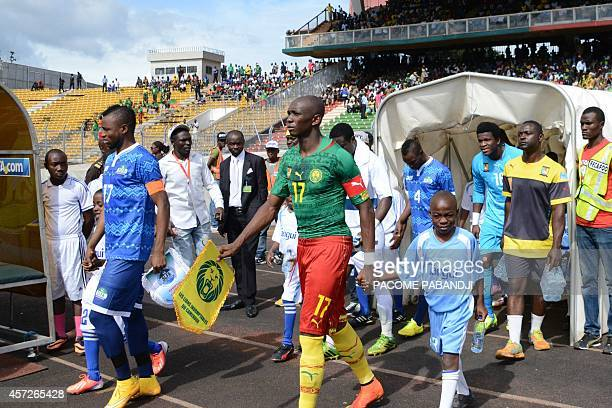 Sierra Leone's captain midfielder Umaru Bangura and Cameroon's captain midfielder Stephane Mbia arrive onto the pitch prior to the 2015 Africa Cup of...