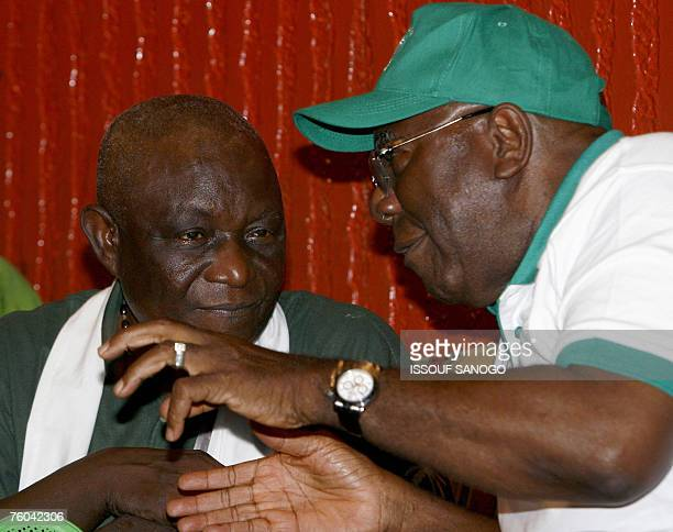 Sierra Leone's outgoing President Ahmad Tejan Kabbah talks with current vice president Solomon Berewa during an election campaign rally in Freetown...