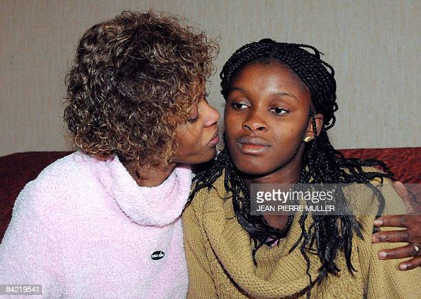 Sierra Leone's refugee Sallay Jabbi kisses her 14-year-old daughter Dora on January 7 in Agen, southwestern France. Jabbi was reunited with her...