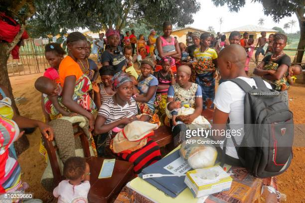 Sierra Leonian women gather during an outreach event at a maternity clinic on May 31, 2017 in Sembehun. Women from Sierra Leone can now pass on their...