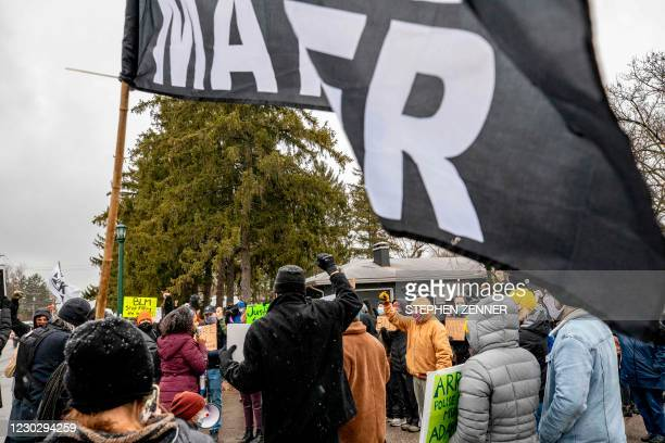 Sierra Mason, a national activist with Consistency Speaks, based out of Canton, Ohio, addresses protestors during a demonstration against the police...