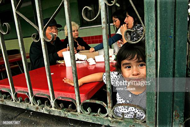 Sierra Uribe dines with her mother and grandparents at Chroni's a classic old food stand on Whittier Boulevard in East Los Angeles May 13 2008...