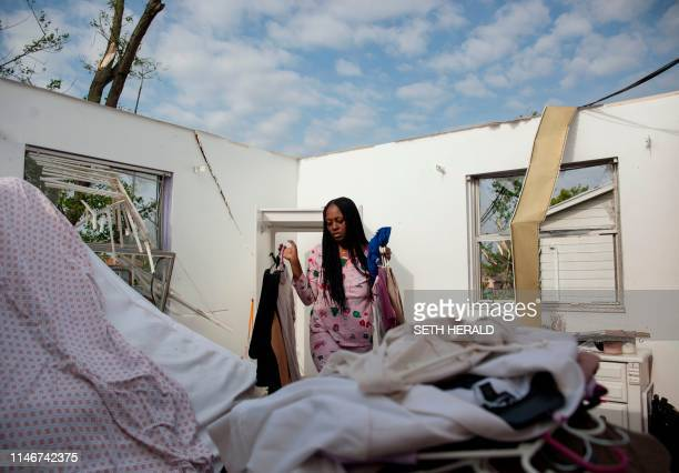 Sierra Waver gathers her belongings in Trotwood Ohio near Dayton on May 28 after powerful tornadoes ripped through the US state overnight causing at...