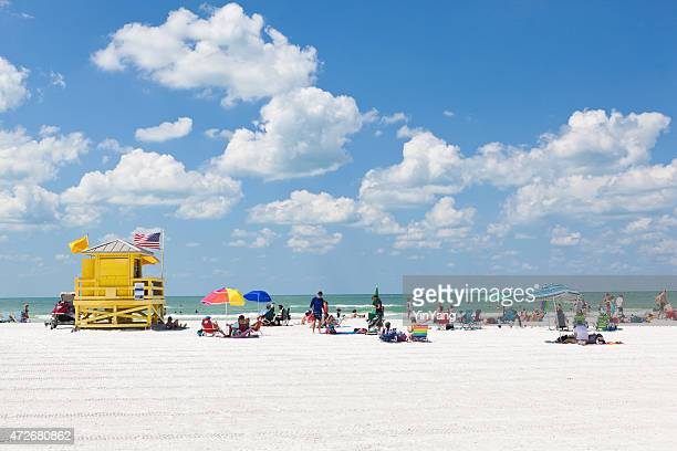 siesta key beach of florida gulf coast with tourists sunbathers - siesta key stock pictures, royalty-free photos & images
