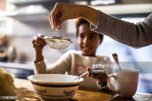 sieving flour in the kitchen! - baked stock pictures, royalty-free photos & images