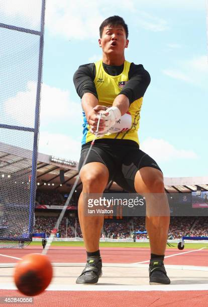 Siew Cheer Jackie Wong of Malyasia competes in the Men's Hammer qualification at Hampden Park during day five of the Glasgow 2014 Commonwealth Games...