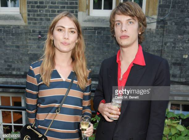 Sif Agustsdottir and Oliver Burslem attend the ALEXACHUNG London Launch Summer 17 Collection Reveal at the Danish Church of Saint Katharine on May 30...