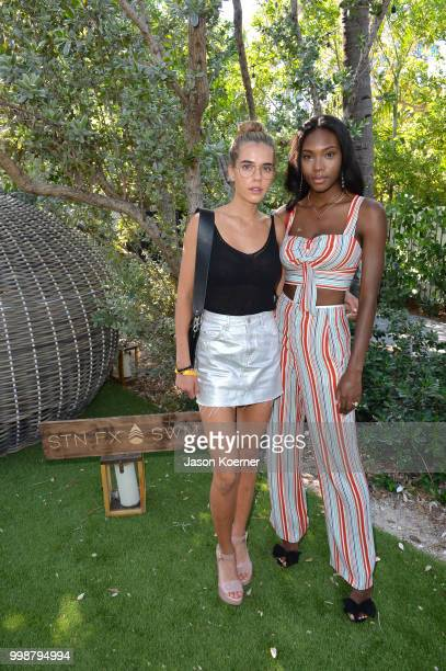 Sif Saga and Afiya Bennett pose backstage for Stone Fox Swim Fall 2018 at Nautilus Hotel on July 14 2018 in Miami Beach Florida
