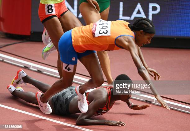 Sifan Hassan of Team Netherlands and Edinah Jebitok of Team Kenya trip and fall during round one of the Women's 1500m heats on day ten of the Tokyo...