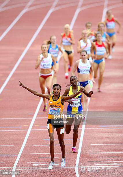 Sifan Hassan of the Netherlands celebrates as she crosses the line to win gold ahead of Adeba Aregawi of Sweden and Laura Weightman of Great Britain...