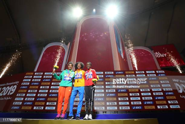 Sifan Hassan of the Netherlands, gold, Letesenbet Gidey of Ethiopia, silver and Agnes Jebet Tirop of of Kenya, bronze, pose during the medal ceremony...