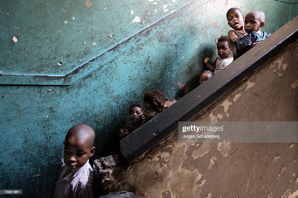 Sifiso Dlomo, left, aged 4 is one of many young children who live in unsafe blocks of flats in the inner city of Johannesburg, circa 2006. This dark, dank, staircase with its pungent stench of urine, is their playground as their families have no funds to send them to creche or school.