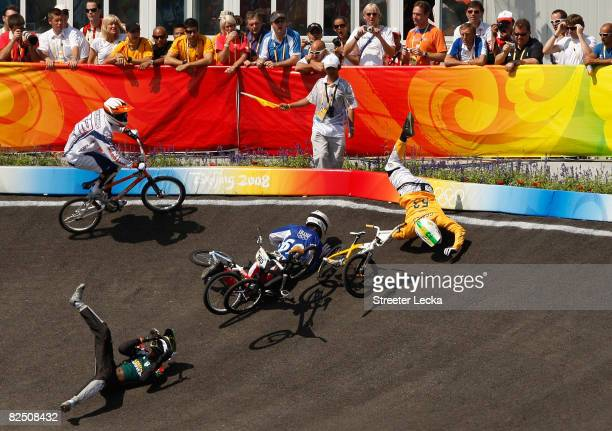 Sifiso Nhlapo of South Africa, Damien Godet of France and Jared Graves of Australia crash in the Men's BMX final run held at the Laoshan Bicycle Moto...